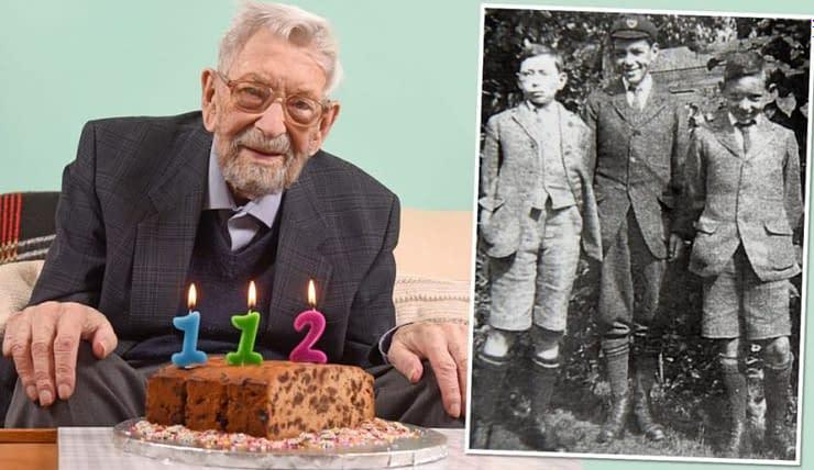 Uomo più vecchio al mondo ritratto in foto con torta e in bianco e nero.
